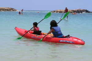 LP Mom and LP Son kayaking in the Aulani Lagoon