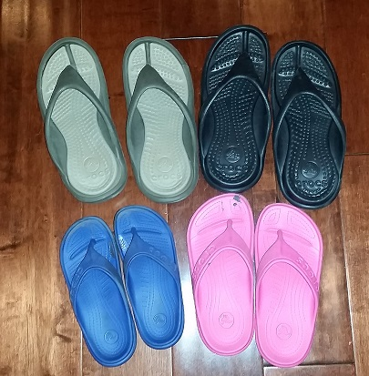 The Family Crocs Collection. Athens Size M4/W6 on top and Kids Baya Flip Size 12 and 1 on the bottom.
