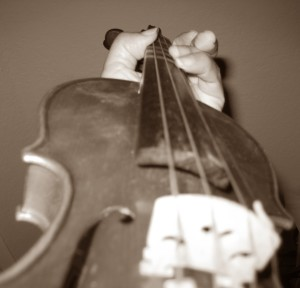 Hands on violin in sepia